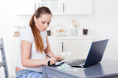 Pregnant  woman with money. Family budget. Royalty Free Stock Photo
