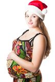 Pregnant woman mother in santa cap. On white background The concept of Beautiful and Health royalty free stock images