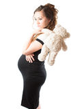 Pregnant woman mother with toy Teddy bear Royalty Free Stock Image