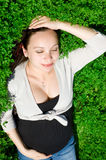 Pregnant woman in nature Stock Photography