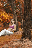 Pregnant woman in nature in autumn Royalty Free Stock Images