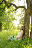 Pregnant woman on nature Royalty Free Stock Photos