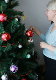 Pregnant woman near christmas tree Royalty Free Stock Images