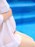 Pregnant woman near the swimming pool Royalty Free Stock Photography