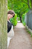 Pregnant woman near tree Stock Photography