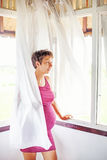 Pregnant woman near the window at home Royalty Free Stock Image