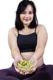 Pregnant woman offers kiwi fruit Stock Photography