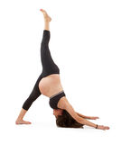 Pregnant woman in one legged downward dog pose Stock Photography