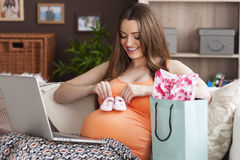 Pregnant woman during online shopping Stock Photo