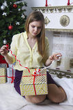 Pregnant woman opening christmas present 12 Royalty Free Stock Photo