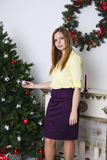 Pregnant woman opening christmas present 2 Royalty Free Stock Photo