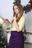 Pregnant woman opening christmas present 1 Stock Images