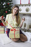 Pregnant woman opening christmas present 13 Stock Image