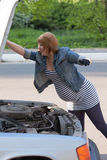 Pregnant Woman Opens Hood of the Car Royalty Free Stock Photos