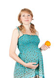 Pregnant woman with orange Stock Photography