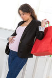 Pregnant woman out shopping Royalty Free Stock Photos