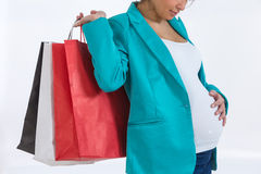 Pregnant woman out shopping Stock Photo