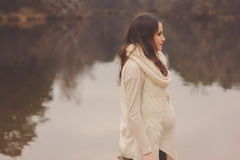 Pregnant woman on outdoor autumn walk, cozy warm mood Royalty Free Stock Image