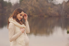 Pregnant woman on outdoor autumn walk, cozy warm mood Royalty Free Stock Photography