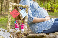 Pregnant woman outdoor in the park Royalty Free Stock Image