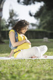 Pregnant Woman in outdoor. Portrait of pregnant Woman in outdoor, relax in green park Royalty Free Stock Image