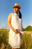 Pregnant woman outdoors Stock Photos