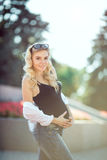 Pregnant woman outdoors in park Royalty Free Stock Photos