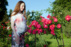 Pregnant woman outdoors Royalty Free Stock Photo