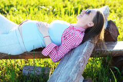 Pregnant woman outdoors Stock Images