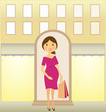 Pregnant woman with package near urban shop Stock Images