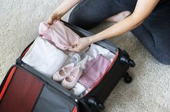 Pregnant woman packing baby stuff for hospital Stock Images