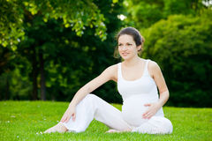 Pregnant woman in the park Royalty Free Stock Images