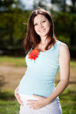 Pregnant woman in park Stock Image