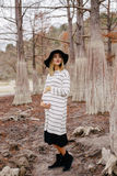 Pregnant woman in park. On a background of trees royalty free stock photos