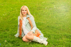 Pregnant woman park grass Royalty Free Stock Images