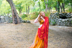 Pregnant woman in the park.Indian girl in dress Royalty Free Stock Images