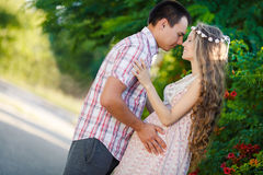 Pregnant woman in the park with a nice husband. Stock Photo