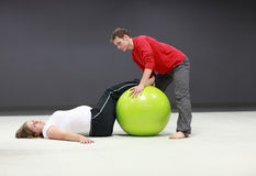Pregnant woman + personal trainer training Royalty Free Stock Photo