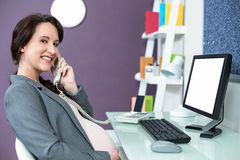 Pregnant woman on the phone Stock Images