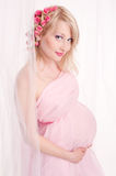 Pregnant woman in a photo studio Royalty Free Stock Photography