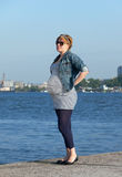 Pregnant Woman on Pier Stock Photo