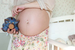 Pregnant woman piggi bank coin Stock Photo