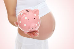 Pregnant Woman and Piggy Bank Royalty Free Stock Photos