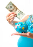 Pregnant woman with a piggy bank Royalty Free Stock Photos