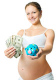 Pregnant woman with a piggy bank. Pregnant young woman with money and piggy bank Stock Photos