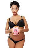Pregnant woman with piggy bank. Royalty Free Stock Image