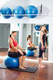 Pregnant woman pilates exercise fitball Stock Photos
