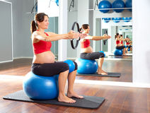 Pregnant woman pilates exercise magic ring Stock Photo