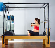 Pregnant woman pilates reformer arms exercise Stock Image