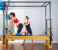 Pregnant woman pilates reformer cadillac exercise Royalty Free Stock Photo